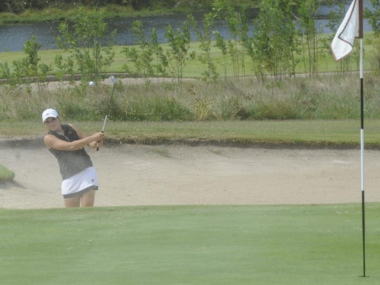 Jonesboro's Taylor Rainey blasts a shot out of the sand on the 18th hole Tuesday at Big Creek Golf & Country Club during the Class 6A State girls golf tournament.