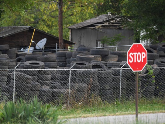 Tires are stacked inside the fenced in area of Quality Tire at 4015 S. Main St. Extension in Homeland Park on Monday.