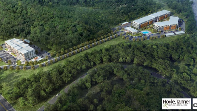 An aerial rendering of the proposed apartment development at 76 Dennett Road. At left is Dennett Road, at right is Interstate 95.