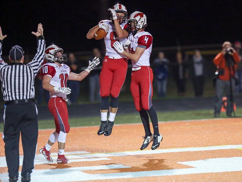Duke Blackwell (No. 6) celebrates his touchdown with New Palestine teammate Brett Luker in the Dragons' win over Columbus East.