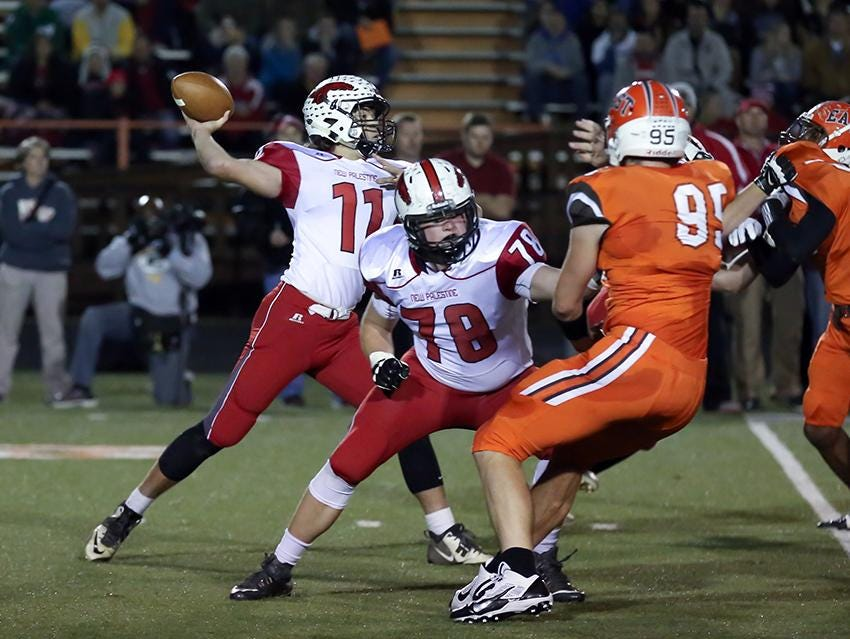 New Palestine QB Alex Neligh drops back to pass in the top-ranked Dragons' win over No. 2 Columbus East Friday night.