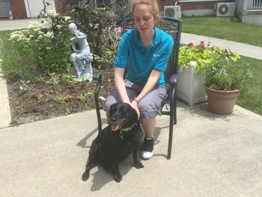 Longview resident aide Liz Rendenback with her dog,