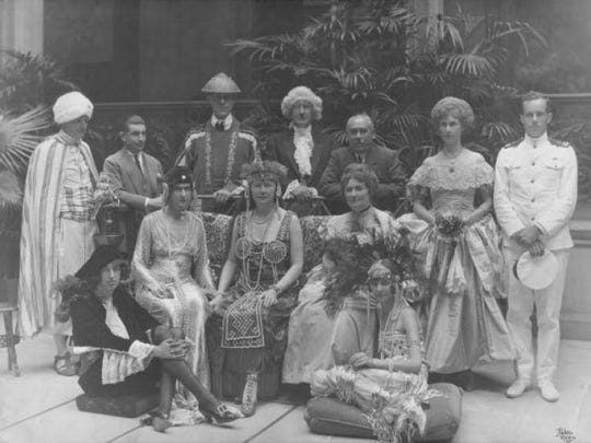 Masquerade Ball in Biltmore House, August 1921. Mrs. Edith Vanderbilt gave a costume party to celebrate her daughter Cornelia's 21st birthday and her coming-out into society. Both Cornelia (seated on a floor cushion on the left) and Mrs. Vanderbilt (behind Cornelia) wore costumes meant to reflect the French Renaissance style of Biltmore House.