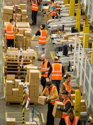 The Amazon Fulfillment Centre prepares for Black Friday on Nov. 25, 2015, in Hemel Hempstead, England.