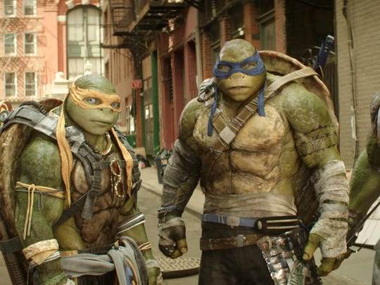"This image released by Paramount Pictures shows, from left, Donatello, Michelangelo, Leonardo and Raphael in a scene from ""Teenage Mutant Ninja Turtles: Out of the Shadows."""