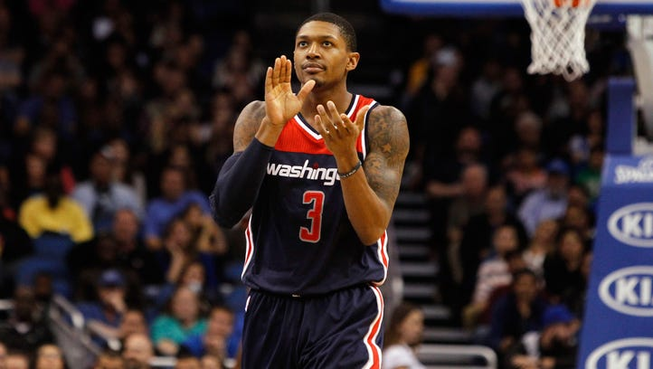 Bradley Beal reacts after a made basket against the Orlando Magic during the second half at Amway Center.