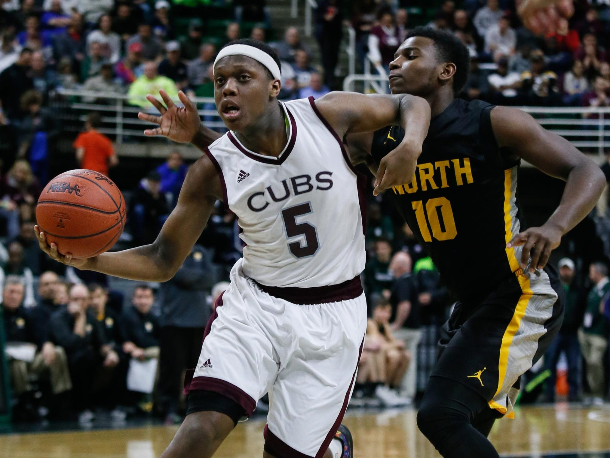 U-D Jesuit's Cassius Winston drives the lane against North Farmington's Amauri Hardy on Saturday. This year's Mr. Basketball winner turned in one of the greatest individual performances in state final history — 31 points, 14 for 16 shooting, nine assists — in the 69-49 win.