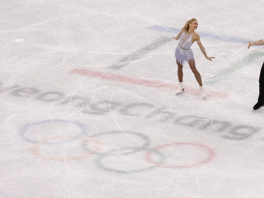 Aljona Savchenko and Bruno Massot of Germany perform in the pair figure skating short program in the Gangneung Ice Arena at the 2018 Winter Olympics in Gangneung, South Korea, Wednesday, Feb. 14, 2018. (AP Photo/Morry Gash)
