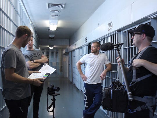 """Members of the """"Chaser"""" production crew discuss a scene"""