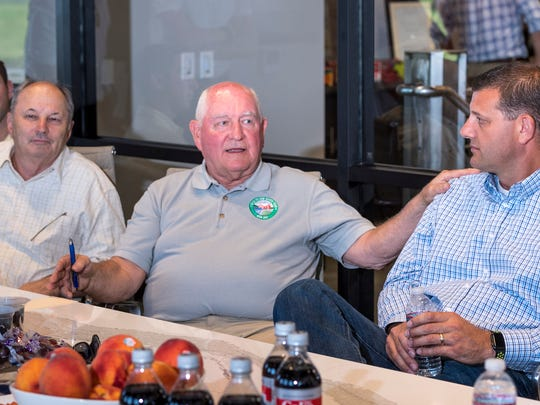 U.S. Secretary of Agriculture Sonny Perdue, center,