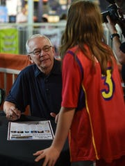 High school basketball coach Joe Lombard talks with fans during an autograph session for the 2016 class of inductees at the Women's Basketball Hall of Fame in Knoxville, Saturday, June 11, 2016.