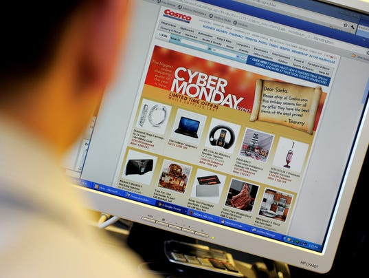 An office worker looks at Cyber Monday s