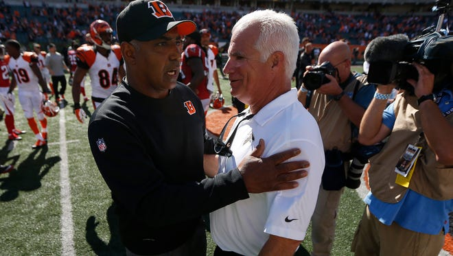 Bengals head coach Marvin Lewis and Falcons head coach Mike Smith chat after Sunday's game at Paul Brown Stadium.