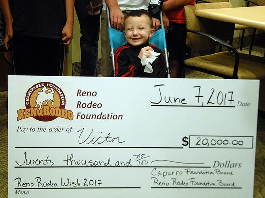 A very happy Victor Sciarrotta, 6, sits behind a huge $20,000 check his family received from Reno Rodeo Foundation at St. Marys Health Center Friday June 9, 2017.  Photo by Marilyn Newton for the Reno Rodeo Foundation