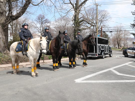 Rockland County mounted unit from the sheriff's department wait for the black women's march at Memorial Park in Nyack on Saturday, April 7, 2018.