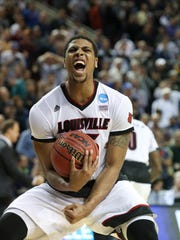 U of L's Wayne Blackshear, #25, celebrates after grabbing the last possession of the ball in the closing seconds of their win against UC Irvine  at the KeyArena in Seattle during the second round of the NCAA tournament.March 20, 2015I love this photo because it shows the intersection of jubilation and relief after U of L came close to losing to a lesser known squad in the NCAA tourney.  Blackshear emerged as the hero that extended their season after losing a key player to discipline issues.
