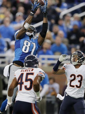 Detroit Lions wide receiver Calvin Johnson (81), defended by Chicago Bears cornerback Kyle Fuller (23), catches a 25-yard reception for a touchdown during the first half of an NFL football game in Detroit, Thursday, Nov. 27, 2014.