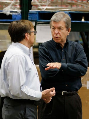 Senator Roy Blunt chats with Bart Brown during a visit to the Ozarks Food Harvest in Springfield on December 28, 2016.