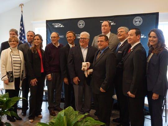 State, local and company officials gathered Monday afternoon to announce Alliance Dispatch Solutions will provide about 100 call center jobs in Hopkins County. Gov. Bill Haslam is sixth from left.