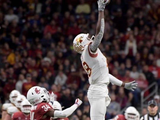 Dec 28, 2018; San Antonio, TX, United States; Iowa State Cyclones wide receiver Hakeem Butler (18) makes a catch in front of Washington State Cougars safety Jalen Thompson (34) during the third quarter in the 2018 Alamo Bowl at Alamodome. Mandatory Credit: Kirby Lee-USA TODAY Sports