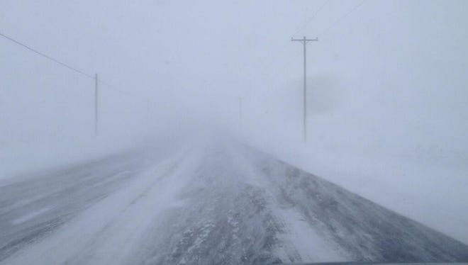 Route 33 near Batavia is covered with blowing snow Tuesday morning.