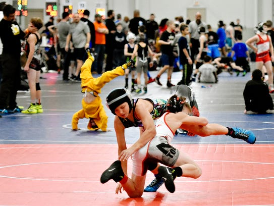 In this file photo, Shane Woolf, 12, center right, of Sussex, New Jersey, takes down Nick Nosler, 11, of Champaign, Illinois, in the 100-pound weight class during Tyrant Duals at Utz Arena on York Fairgrounds in York City, Sunday, Jan. 22, 2017. Tyrant Duals was new to York County in 2016 and helped make the region a top tourist destination that year.