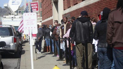 Voters line up for early voting outside the board of elections in downtown Cincinnati in 2012.