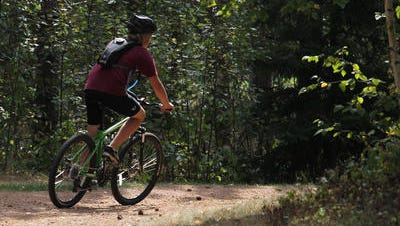 A mountain biker rides at Nine Mile County Forest Recreation Area in Rib Mountain.