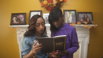 Latina Hart, 45, and her daughter Rashona Nesmith (left) look over funeral documents in their Gloucester County home. Hart is a Samaritan Hospice patient, who recently moved in with her daughter. Hart has taken all the necessary steps to prepare for her death.