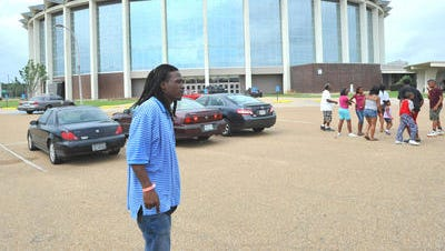 Allen Russell stands on the parking lot at the Mississippi Coliseum on the Mississippi Fairgrounds in Jackson in this file photo.