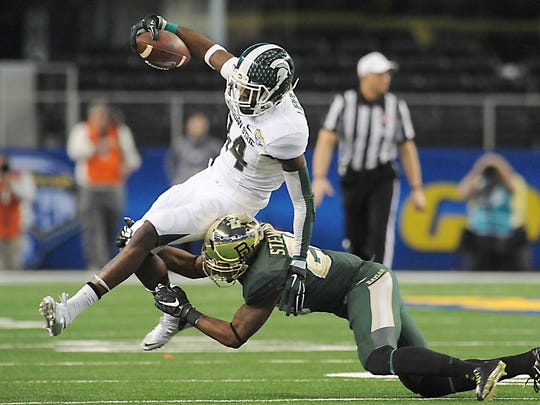 MSU's  Tony Lippett is hauled down by Baylor's  Orion