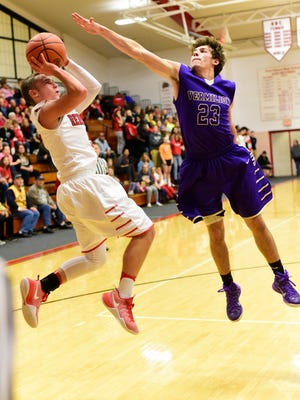 Port Clinton's Max Rumbarger, shooting a fade-away as a junior, is second in the Bay Division in scoring at 16.4 points per game.