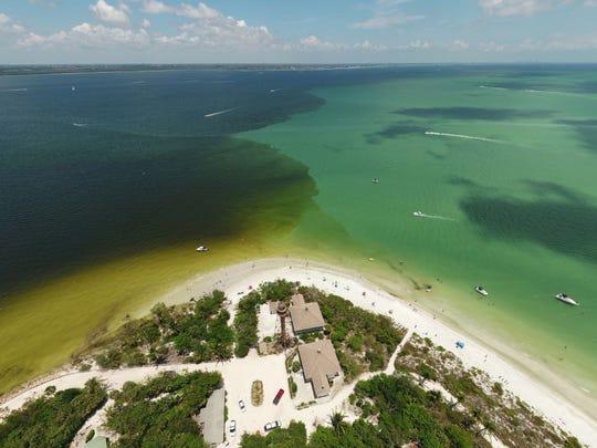 Water from Lake Okeechobee releases flows by Sanibel Island on June 3.