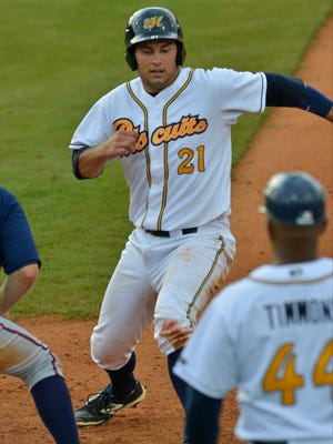 Montgomery Biscuits' Luke Maile (21) beats the throw back on first base during their game with Mississippi Braves at Riverwalk Stadium on Sunday, June 1, 2014.
