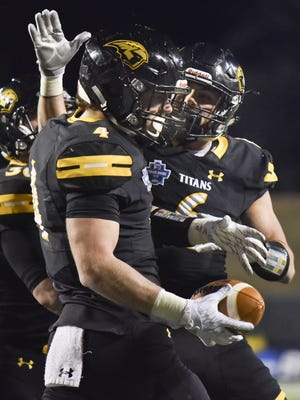 Dylan Hecker (4), who scored the UWO touchdown in the Stagg Bowl, will be one of the veteran players returning to the offensive side of the ball for the Titans