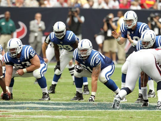 Indianapolis Colts quarterback Peyton Manning (18) waits for the ball as linemen (left to right) Indianapolis Colts center Jeff Saturday (63), Indianapolis Colts guard Jamey Richard (61) and Indianapolis Colts offensive tackle Charlie Johnson (74) line up.