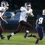 Canal Winchester's Maon Ingram looks for running room in a 2014 nonconference game against Lancaster.