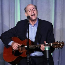 NEW YORK, NY - APRIL 08:  Musician James Taylor performs during the 2014 UJA-Federation of New York's Leadership Awards Dinner at Pier Sixty at Chelsea Piers on April 8, 2014 in New York City.  (Photo by Taylor Hill/FilmMagic)