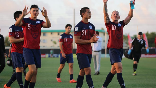 Micah Paulino (5), Marcus Lopez (21), and Jason Cunliffe (10) acknowledge the fans after Guam's final home match of the 2018 FIFA World Cup Russia and AFC Asian Cup UAE 2019 Joint Preliminary Qualification Round 2. The team lost 3-2 to Hong Kong at the EAFF E-1 Football Championship on Sunday.