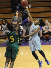 Hardin-Simmons' Taylor Gaffney, right, puts up a shot as Belhaven's Tajee Harper (5) defends. The Blazers beat HSU 75-65 on Saturday, Dec. 17, 2016 at the Mabee Complex.