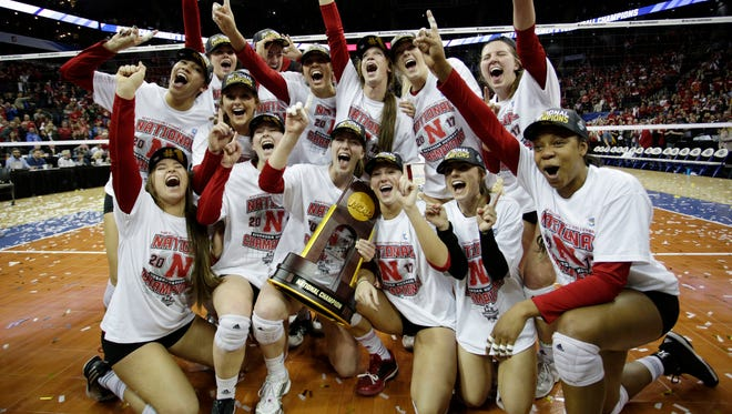 Nebraska players celebrate after beating Florida to win the 2017 NCAA women's volleyball national championship.
