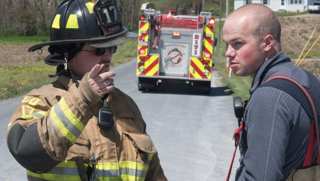 New Franklin Vounteer firefighters Charles Golden, left, and Kade Burke are on the scene of a publc service call Monday, April 30, 2018 at Newcomer Road, Guilford Township.