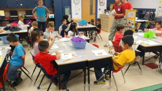 Memorial Elementary School students followed the building blocks of Junior Achievement with the help of Deming High School JROTC cadets. Pictured are, standing from left, cadets Niko Rosell, Saul Hernandez and Lucas Holm.