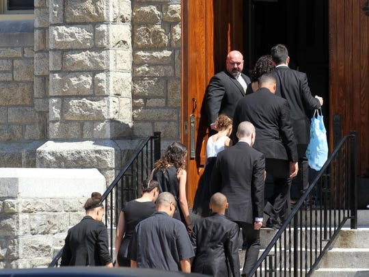 Family members arrive at the Holy Spirit Church in Asbury Park Monday, June 22, 2015, for Tamara Seidle's funeral service. SEIDLEFUNERAL0622A~