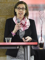 Dr. Julie Ostrander, University of Minnesota cancer researcher and professor, talks about breast cancer Tuesday at the Husky Den in Herb Brooks National Hockey Center. Ostrander discussed statistics, risk factors and prevention strategies for cancer.