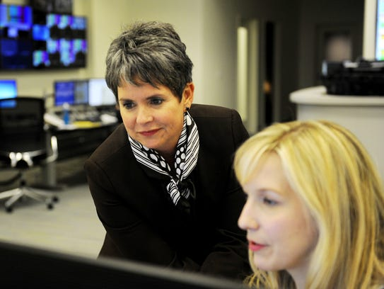 In this picture taken Nov. 12, 2015, then WSMV news anchor Demetria Kalodimos, left, works with producer Mary Katherine Rooker in their newsroom.