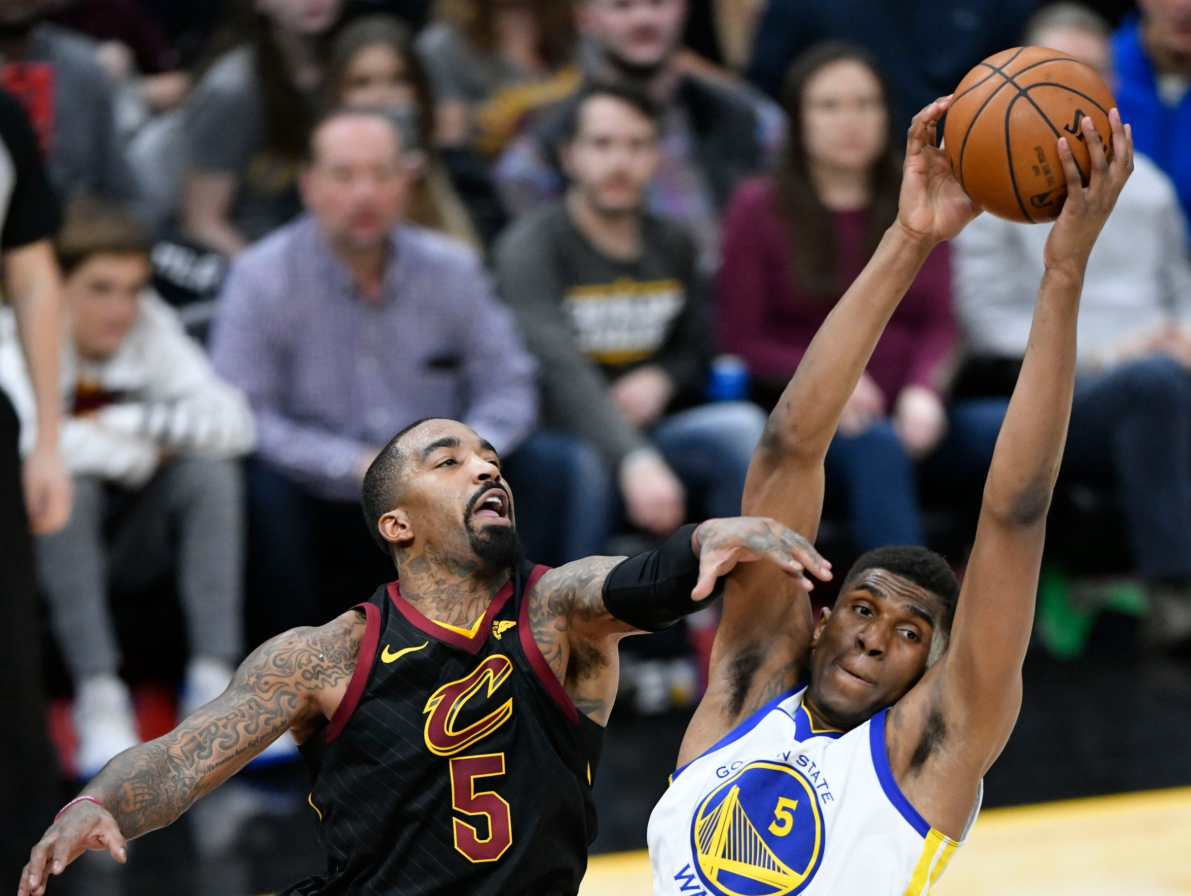 The Golden State Warriors' Kevon Looney rebounds the