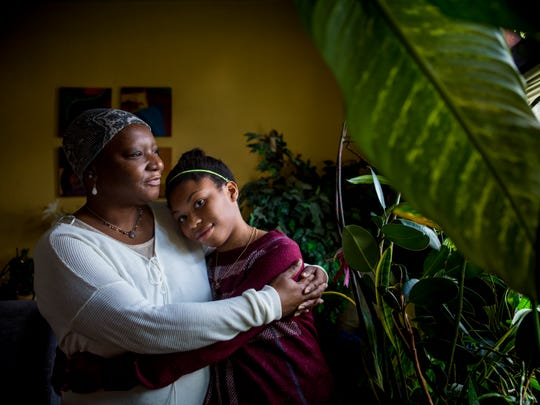 Valerie Underwood-Powers embraces her granddaughter, Akira Underwood. Akira has lived with her grandparents since she was less than a year old. Akira loves to read and dreams of being a librarian one day, but she struggles with science and math in school. Valerie was diagnosed with ovarian cancer in June, and the family doesn't have money to pay for a tutor for Akira.