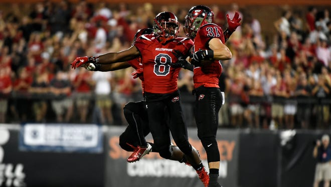 Western Kentucky's Marcus Ward (8) and teammates celebrate after forcing an incomplete pass by Rice during the an NCAA college football game, Thursday, Sept. 1, 2016, in Bowling Green, Ky. (AP Photo/Michael Noble Jr.)