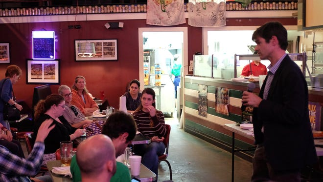 """Jeff Carney presents his """"Building for Change"""" to a Science Café crowd at Schlitz and Giggles Tuesday."""